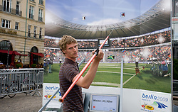 Boy gaming with Javelin Throw at Branderburger Tor where is temporary Stadium of Culture due to the 12th IAAF World Athletics Championships at the Olympic Stadium, on August 18, 2009 in Berlin, Germany. (Photo by Vid Ponikvar / Sportida)