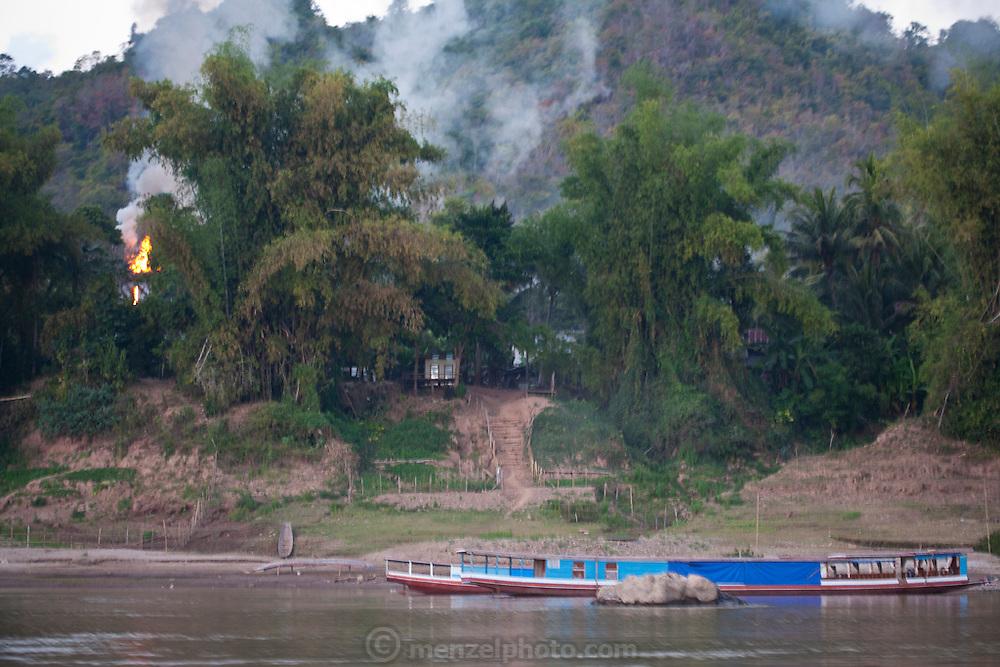 Boat trip up to the Thousand Buddha Caves on the Mekong River, Luang Prabang, Laos..