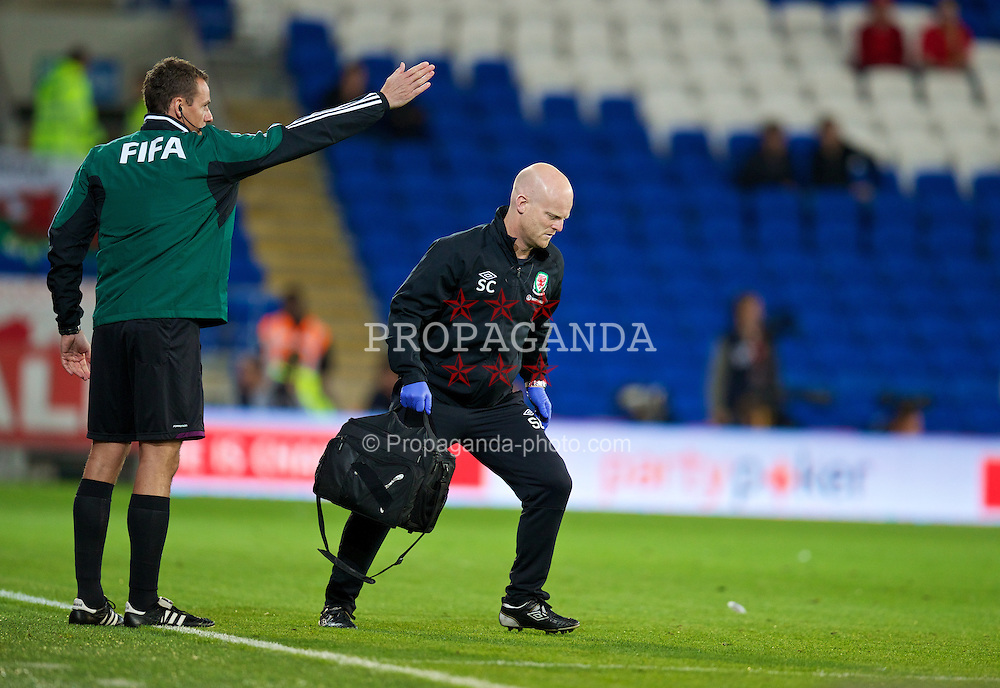 CARDIFF, WALES - Tuesday, September 10, 2013: Wales' physiotherapist Sean Connelly runs on to treat an injury during the 2014 FIFA World Cup Brazil Qualifying Group A match against Serbia at the Cardiff CIty Stadium. (Pic by David Rawcliffe/Propaganda)