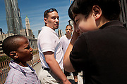 NEW YORK, NY &ndash; MAY 25, 2011: Isaiah Brown, Sergio Alvarez and Alex Rodriguez surround twenty year-old Basilio Bonilla on a field trip to New York City. Bonilla is a volunteer with the Donegan Elemntary School and a candidate for the Bethlehem Area School Board.<br />