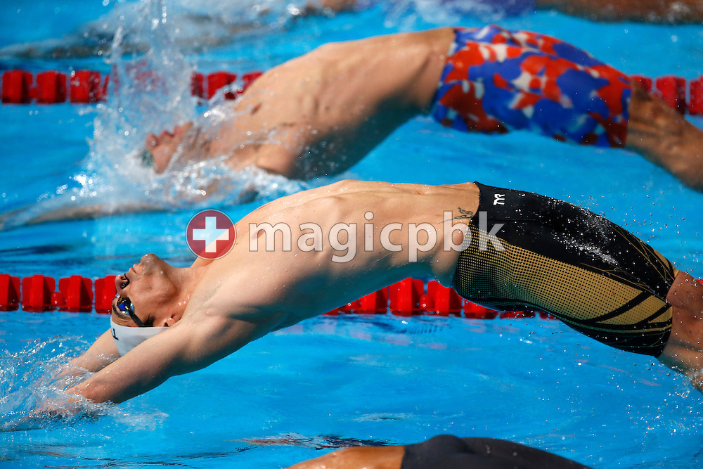 Camille Lacourt (bottom) of France and David Plummer of the United States of America (USA) compete in the men's 100m Backstroke Heats during the 15th FINA World Aquatics Championships at the Palau Sant Jordi in Barcelona, Spain, Monday, July 29, 2013. (Photo by Patrick B. Kraemer / MAGICPBK)