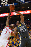 April 30, 2019; Oakland, CA, USA; Houston Rockets forward PJ Tucker (17) and Golden State Warriors center Kevon Looney (5) fight for the rebound during the third quarter in game two of the second round of the 2019 NBA Playoffs at Oracle Arena. The Warriors defeated the Rockets 115-109.