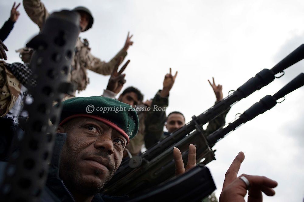 Anti government fighters celebrate close by a anti-aircraft gun in benghazi, Libya..ALESSIO ROMENZI