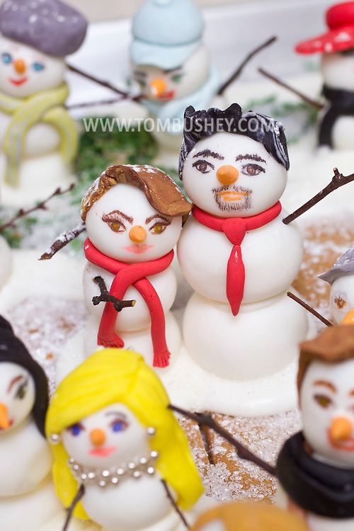 Middletown, New York - Tiny snowmen represent the owners of  Something Sweet Dessert Cafe and some of their customers on  Nov. 23, 2014. ©Tom Bushey / The Image Works