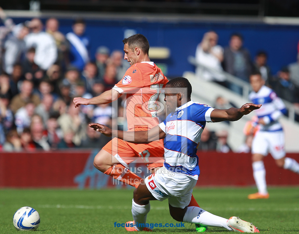 Nedum Onuoha of Queens Park Rangers and Scott McDonald of Millwall during the Sky Bet Championship match at the Loftus Road Stadium, London<br /> Picture by John Rainford/Focus Images Ltd +44 7506 538356<br /> 26/04/2014