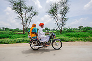 An Elderly Indian Couple on their bike in rural Rajasthan