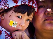 30 NOVEMBER 2017 - YANGON, MYANMAR: A child with a Vatican flag sticker on his cheek during the Papal Mass at St. Mary's Cathedral in Yangon. Thursday's mass was his last public appearance in Myanmar. From Myanmar the Pope went on to neighboring Bangladesh.    PHOTO BY JACK KURTZ