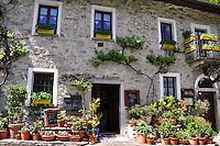 Ticino, Southern Switzerland. Beautiful, rustic, Ticinese roadside grotto.