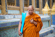 A Buddhist Thai Monk walking along Wat Phra Kaew - Emerald Buddha Temple