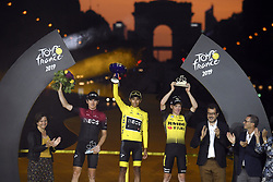 July 28, 2019, France: PARIS, FRANCE - JULY 28 : THOMAS Geraint (GBR) of TEAM INEOS, BERNAL GOMEZ Egan Arley (COL) of TEAM INEOS and KRUIJSWIJK Steven (NED) of TEAM JUMBO - VISMA pictured during the podium ceremony after stage 21 of the 106th edition of the 2019 Tour de France cycling race, a stage of 128 kms between Rambouillet and Paris Champs-Elysees on July 28, 2019 in Paris, France, 28/07/2019 (Credit Image: © Panoramic via ZUMA Press)