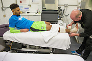Forest Green Rovers Kaiyne Woolery(14) being treated before the match by physio Ian Weston during the Vanarama National League match between Forest Green Rovers and Boreham Wood at the New Lawn, Forest Green, United Kingdom on 11 February 2017. Photo by Shane Healey.