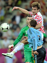 (L) Croatia's goalkeeper Stipe Pletikosa (nr01) & (R) Croatia's Nikica Jelavic (nr09) fight for the ball with Spain's Gerard Pique (nr03) during the UEFA EURO 2012 Group C football match between Spain and Croatia at Gdansk Arena in Gdansk on June 18, 2012...Poland, Gdansk, June 18, 2012..Picture also available in RAW (NEF) or TIFF format on special request...For editorial use only. Any commercial or promotional use requires permission...Photo by © Adam Nurkiewicz / Mediasport