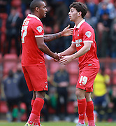 Leyton Orient midfielder Scott Kahsket is congratulated by Leyton Orient striker Jay Simpson on scoring a late equiliser during the Sky Bet League 2 match between Leyton Orient and Oxford United at the Matchroom Stadium, London, England on 17 October 2015. Photo by Bennett Dean.