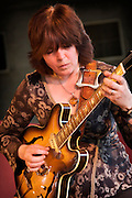 Epiphone Casino played by Deirdre Cartwright at a Gig at the Frontroom of the Queen Elizabeth Hall, London. Looks like a Gibson made 1962 Casino tabacco sunburst...The Casino in 1961 had a dot inlay and black pick-up covers. The 1962 Casino had parallelogram inlays and nickel pick-up covers...An Archtop hollow body with the same dimensions and construction as the Gibson ES-330.