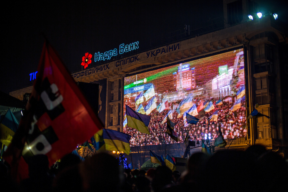 A lot of protesters stays on the Independance Square after dark, waving Ukrainian flags and listening to the musicians who are playing on the main stage.