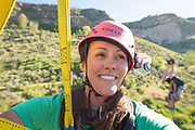 Woman on zip line with male upside down right behind her while zip lining in the Snake River Canyon with Zip the Snake in Twin Falls, Idaho. MR