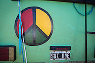 A peace symbol on the back of an old Argentinian bus parked at the site set up for football fans who had nowhere to stay but the tents, campervans, cars and caravans that they had bought with them. The site, at the Terreirao Do Samba, Rio de Janeiro, Brazil, was arranged by the city government once they realised the number of fans in this situation was significant and rather than having them scattered about the sity they offered secure, enclosed accommodation with sanitation and water. The majority of fans at the site were Argentinian but there were also people from Chile, USA, Uruguay and Colombia. <br /> Picture by Andrew Tobin/Focus Images Ltd +44 7710 761829<br /> 06/07/2014