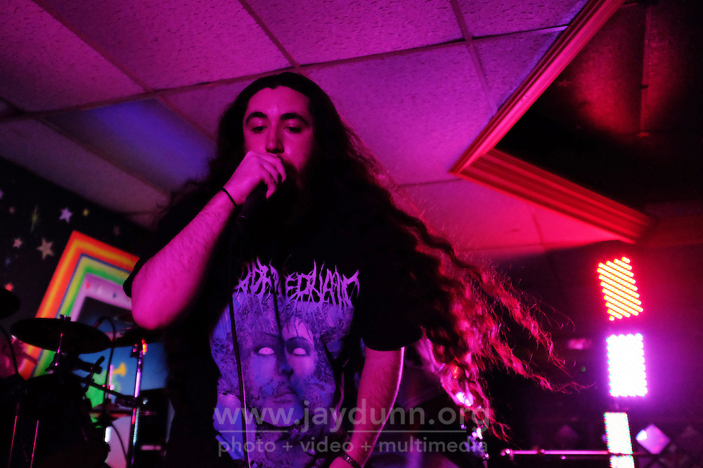 Scenes from a metal show on  September 11th, 2015, held as a tribute to friend and fellow musician Adrian Garcia of Salinas, who was killed in a hit-and-run last year. Burial Procession, Wretched Remains, Genethliac, Gardens, and Asterion, all local bands, filled La Movida Nightclub on E. Alisal St. with defiant music and praise for Garcia's positive spirit.