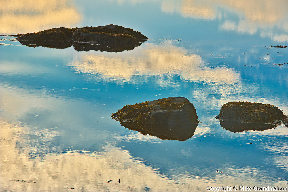 Rocks and clouds at sunrise, Harrigan Cove, Nova Scotia, Canada