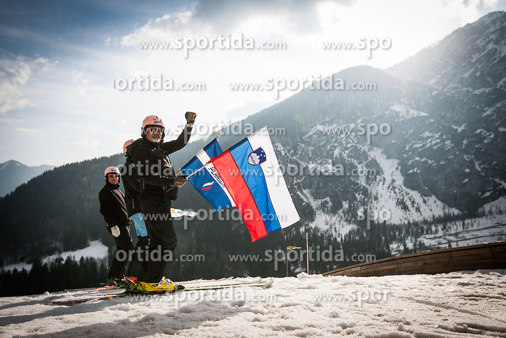 Flag holders with Slovenian national flag, flag of Planica and official flag of FIS during Large Hill Individual Event at 3nd day of FIS Ski Jumping World Cup Finals Planica 2014, on March 22, 2014 in Planica, Slovenia. Photo by Grega Valancic / Sportida
