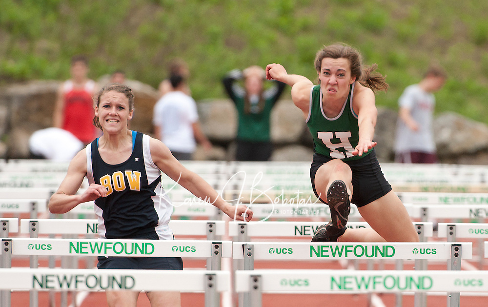 Mariellen Breton of Bow and Libby Wetterer of Hopkinton compete in the hurdles final Saturday during the NHIAA Division III State Track Championships.  (Karen Bobotas/for the Concord Monitor)