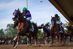California Chrome with Victor Espinoza up out in front at the last turn in the 140th running of the Kentucky Derby at Churchill Downs May 3, 2014. Photo by Jonathan Palmer