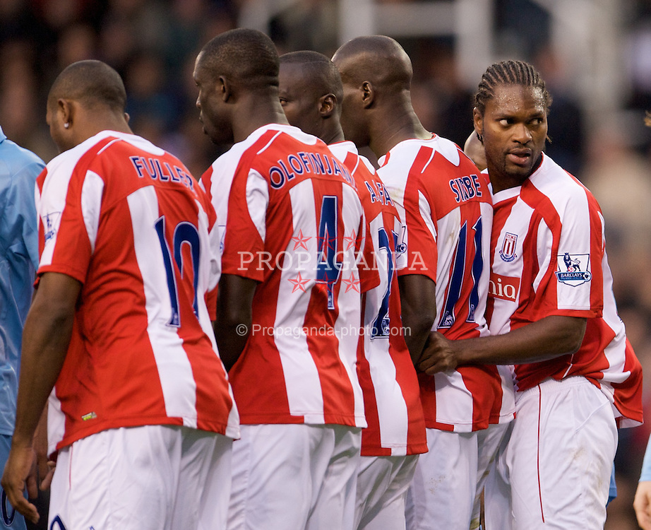 STOKE, ENGLAND - Sunday, October 19, 2008: Stoke City's Salif Diao lines up a defensive wall during the Premiership match against Tottenham Hotspur at the Britannia Stadium. (Photo by David Rawcliffe/Propaganda)