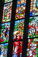 Milan, Italy, Duomo Cathedral. Stained glass window consisting of indivual panes, each with it's own scene.