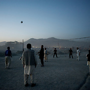 November 14, 2012 - Kabul, Afghanistan: Local afghan men play volleyball beside a garbage dump site in the outskirts of Kabul. (Paulo Nunes dos Santos)