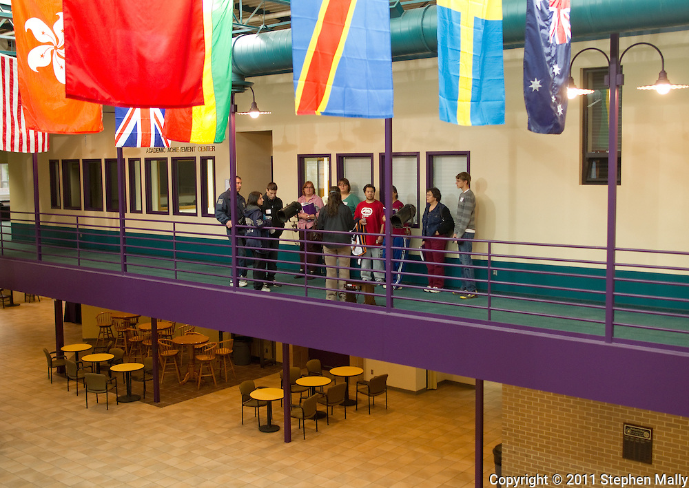 Trinity Renchin (back towards camera), student ambassador, leads a tour of prospective students and their parents at an open house at Waldorf College in Forest City, Iowa on Saturday, May 14, 2011.