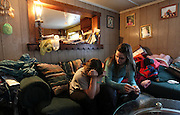 """Pownal, VT -  Friday, Feb. 7, 2014:   Recovering addict Stephanie Predel, 23, right, with her younger sister Brianna Wasieleuski, 11, left, sitting at home in the living room.   Federal studies show that Vermont has one of the highest per capita uses of illicit drugs. """"There's just nothing here,"""" said Stephanie Predel, 23, who went from painkillers to heroin, hiding her habit from her children by shooting up in the bathroom. """"Come wintertime, everybody just sits inside using."""" Stephanie, who says she has not used heroin since November, has lost custody of her children. She has no job and no home and for now is staying with her mother, Jennifer Rose, 42, who blames herself for her daughter's descent into drugs. """"Because I had a dysfunctional family growing up, I did a poor job of bringing her up,"""" Ms. Rose said. She said she did not know how to break the cycle.  CREDIT: Cheryl Senter for The New York Times"""