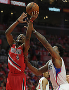 Portland Trail Blazers forward Maurice Harkless #4 is fouled by Los Angeles Clippers center DeAndre Jordan #6 in the first half. The Los Angeles Clippers played the Portland Trail Blazers in game 5 of the NBA Western Conference Playoffs first round. Los Angeles, CA.  April 27, 2016. (Photo by John McCoy/Southern California News Group)