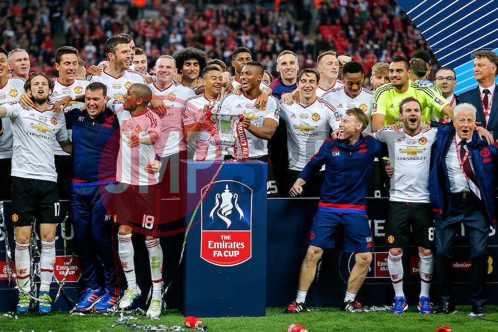 Goalscorer Jesse Lingard Cup with Luis Antonio Valencia of Manchester United as they and their teammates celebrate after winning the FA Cup with a 1-2 victory after the game went to extra time - Mandatory byline: Rogan Thomson/JMP - 21/05/2016 - FOOTBALL - Wembley Stadium - London, England - Crystal Palace v Manchester United - FA Cup Final.