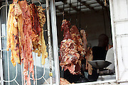 Tanzania, Rural Butcher, meat hanging outside the window