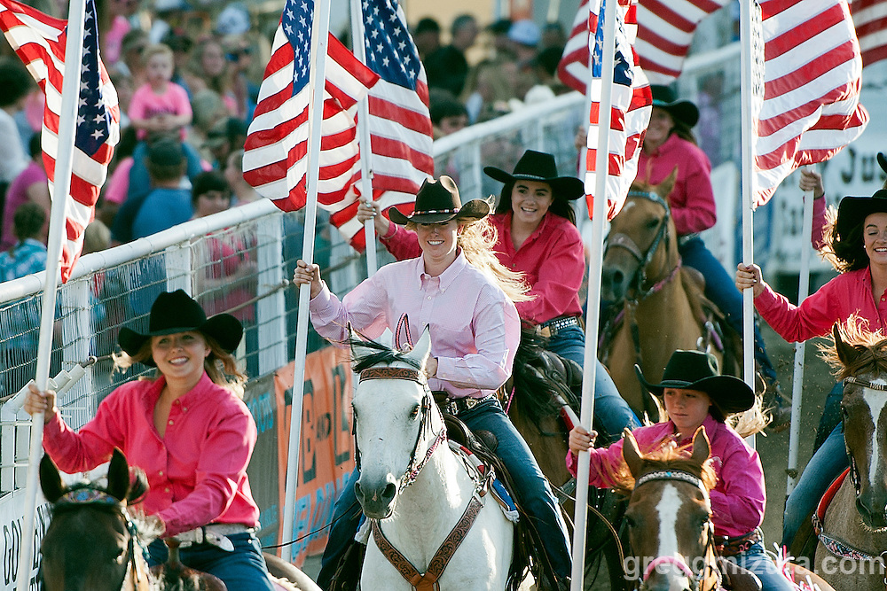 Brogan Bair (riding white horse) during the Grand Entry flag presentation at the Vale 4th of July Rodeo on July 2, 2016 in Vale, Oregon.