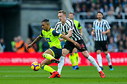 Sean Longstaff (#36) of Newcastle United applies pressure to Juninho Bacuna (#7) of Huddersfield Town during the Premier League match between Newcastle United and Huddersfield Town at St. James's Park, Newcastle, England on 23 February 2019.