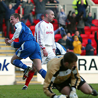 St Johnstone v Inverness Caley Thistle..  04.02.03<br />Chris Hay celebrates goal one after slotting the ball past Mark Brown<br /><br />Pic by Graeme Hart<br />Copyright Perthshire Picture Agency<br />Tel: 01738 623350 / 07990 594431