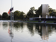 East Meadow, New York, USA. Summer 2017. Eisenhower Park pond area, with Nassau County Eisenhower Park September 11, 2001 Memorial on west side of pond and War Memorials on east side of pond.
