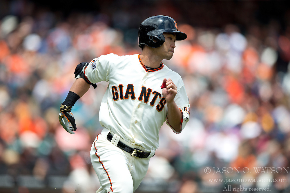 SAN FRANCISCO, CA - MAY 21:  Nori Aoki #23 of the San Francisco Giants runs to first base after hitting a single against the Los Angeles Dodgers during the first inning at AT&T Park on May 21, 2015 in San Francisco, California.  (Photo by Jason O. Watson/Getty Images) *** Local Caption *** Nori Aoki