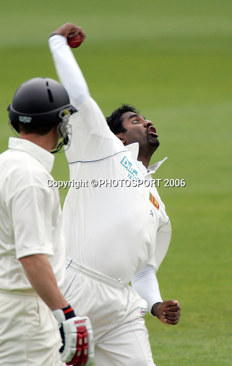 New Zealand batsman Craig Cumming watches Sri Lankan bowler Muttiah Muralitheran in action during the first cricket test match between the Black Caps and Sri Lanka at Jade Stadium, Christchurch, New Zealand, on Thursday 7 December, 2006. Photo: Andrew Cornaga/PHOTOSPORT.<br />