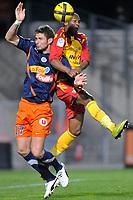 FOOTBALL - FRENCH CHAMPIONSHIP 2010/2011 - L1 - MONTPELLIER HSC v RC LENS - 19/03/2011 - PHOTO SYLVAIN THOMAS / DPPI - OLIVIER GIROUD (MON) / ALASSANE TOURE (RCL)