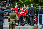 The field marshall lays a wreath at the memorial - The Combined Cavalry OCA Parade, Hyde Park. More than two thousand cavalrymen march in a mixture of uniforms or suits with bowler hats (for officers only) and furled umbrellas creating a quintessentially British scene. It is the 93rd Annual Parade and Service of The Combined Cavalry Old Comrades Association at the Cavalry Memorial adjacent and the Bandstand in Hyde Park. Field Marshal Baron Guthrie GCB, LVO, OBE, DL Colonel The Life Guards and Gold Stick took the salute at the march past for both serving and former soldiers of all the Regiments of Regular Cavalry and many Yeomanry Regiments.
