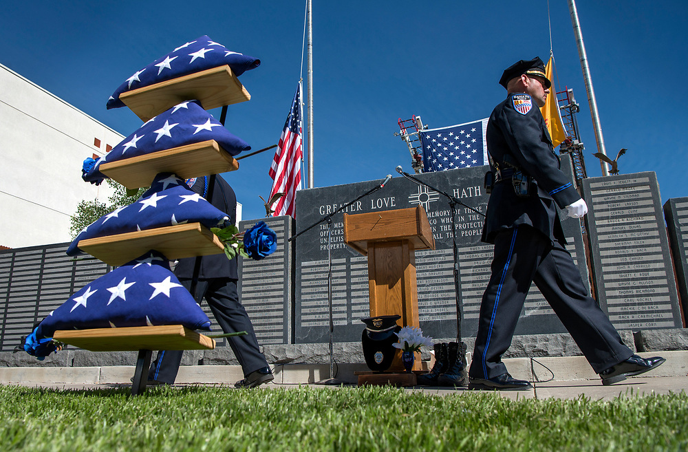 em052417o/a/Santa Fe Police Officer William Cordova, right, and others perform a changing of the guard during the annual New Mexico Law Enforcement Memorial Service at the Department of Public Safety Law Enforcement Academy in Santa Fe, Wednesday May 24, 2017. This year three names were added to the wall, Hatch Police Officer Jose Chavez, Alamogordo Police Officer Clint Corvinus and Valencia County Sheriff's Deputy Ryan Thomas. Gov. Susana Martinez spoke at the event.  (Eddie Moore/Albuquerque Journal