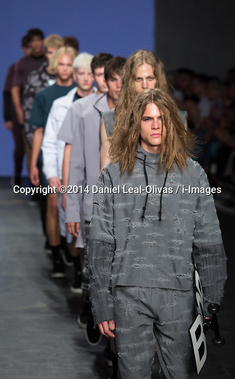 Image ©Licensed to i-Images Picture Agency. 15/06/2014. London, United Kingdom. London Collections: Men. A model presents a creation by MAN during the first day of the Spring/Summer 2015 \'London Collections: Men\' fashion event in London. The Old Shorting Office. Picture by Daniel Leal-Olivas / i-Images