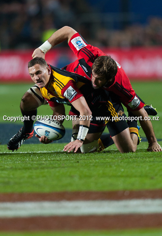 Chiefs' Tawera Kerr-Barlow is tackled by Crusaders' Samuel Whitelock during the Super Rugby Semi Final won by the Chiefs (20-17) against the Crusaders at Waikato Stadium, Hamilton, New Zealand, Friday 27 July 2012. Photo: Stephen Barker/Photosport.co.nz