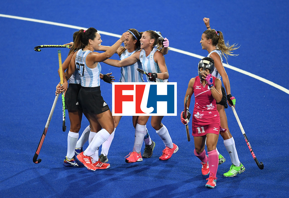 Japan's Akane Shibata reacts as Argentina players celebrate a goal during the women's field hockey Argentina vs Japan match of the Rio 2016 Olympics Games at the Olympic Hockey Centre in Rio de Janeiro on August, 8 2016. / AFP / MANAN VATSYAYANA        (Photo credit should read MANAN VATSYAYANA/AFP/Getty Images)