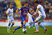 VALENCIA, SPAIN - MAY 10: (L) Miguel Angel Herrero of Levante UD  is followed by (R) Alvaro Gonzalez of Real Zaragoza during the Liga BBVA between Levante UD and Real Zaragoza at the Ciutat de Valencia stadium on May 10, 2013 in Valencia, Spain. (Photo by Aitor Alcalde Colomer).