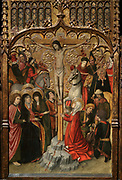 Calvary, tempera, stucco reliefs and gold leaf, 1465-80, by Jaume Huguet, 1412-92, in Gothic style, in the Museu Nacional d'Art de Catalunya, Barcelona, Spain. This is the central panel from the Altarpiece of Pertegas, originally from the Church of San Martin de Pertegas Sant Celoni, Valles Oriental. The left hand panel depicts the Martyrdom of St Bartholomew and the right hand panel, the death of St Mary Magdalene. Picture by Manuel Cohen