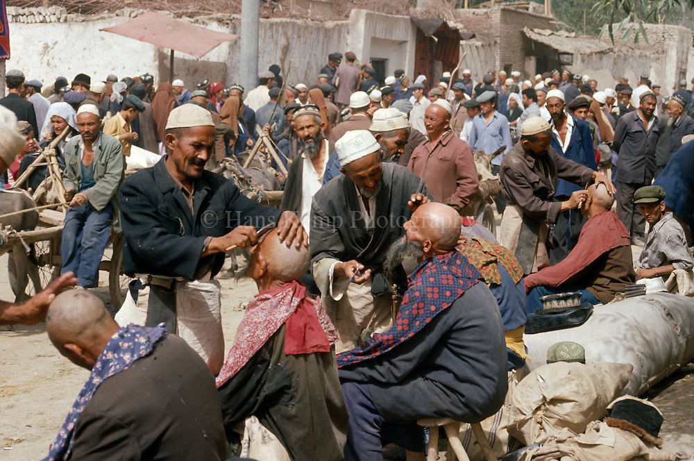 Barbers at the Kashgar sunday market, 1988