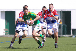 May 5, 2013; Bronx, NY; USA; Leitrim's Wayne McKeon (7) carries the ball while being chased by New York's Gary O'Driscoll (8) during the first half at Gaelic Park.